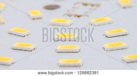 SMD LEDs on Aluminum Printed Circuit Board as background ** Note: Shallow depth of field