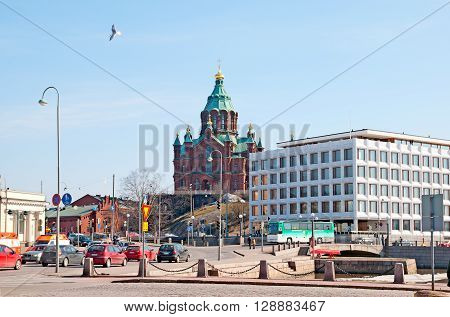 HELSINKI, FINLAND - APRIL 10, 2010: Katajanokka district. The main office of the Stora Enso Oyj Company, the Finnish pulp and paper manufacturer, On the left side is Uspenski Cathedral.