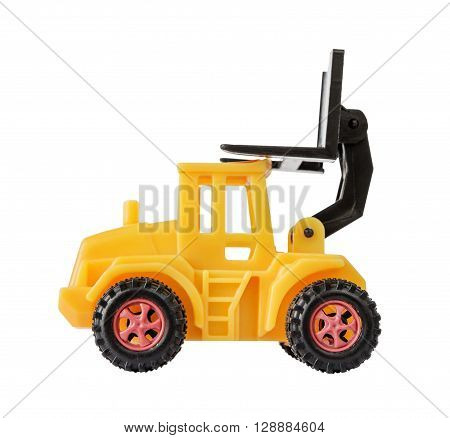 Yellow toy forklift made of plastic with a raised loader isolated on a white background side view