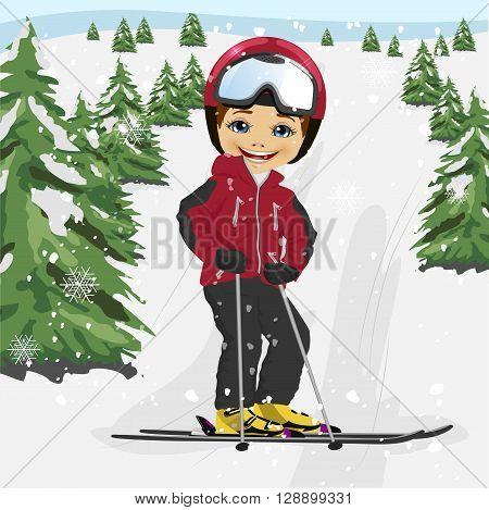 Cute little boy wearing red ski jacket and a helmet skiing in the ski resort