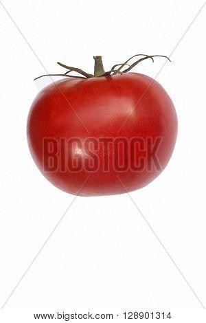 Beefsteak tomato (Solanum lycopersicum). Image of single tomato isolated on white background