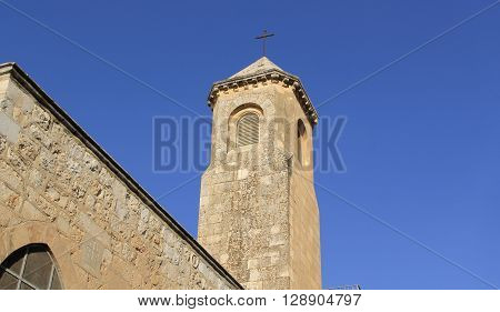 Copy space with stone Minaret with a cross in Jerusalem, Israel.  Used to call people to prayer.