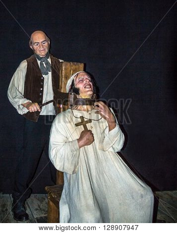 LONDON UK - JUNE 7 2015: The executioner and the scene of the execution of strangulation  at one of halls of historical part of Madame Tussauds wax museum. Madame Tussauds London is famous for recreating famous people and celebrities in wax.