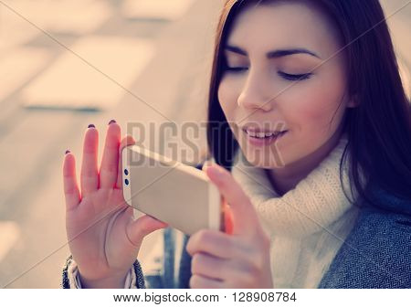 Young Girl Taking Photo On Her Smart Phone