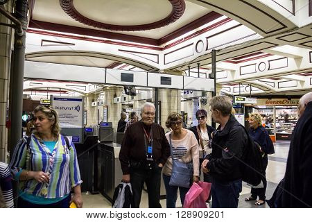 LONDON UK - JUNE 7 2015: Unidentified tourists inside the King's Cross underground station