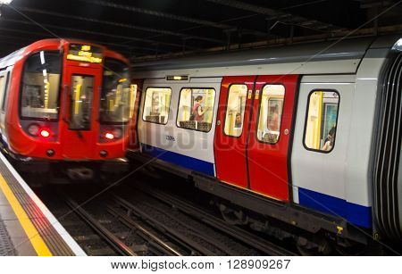 LONDON UK - JUNE 7 2015: Train departs from the King's Cross St.Pancras underground station the King's Cross underground station