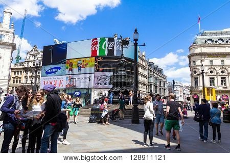LONDON UK - JUNE 7 2015:Unidentified people at Piccadilly Circus road junction built in 1819 famous tourist attraction links to West End Regent Street Haymarket Leicester Square