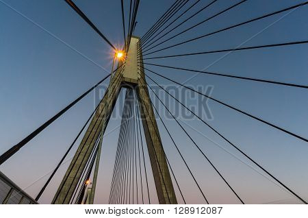 ANZAC Bridge pylon with steel cables against sunset sky Sydney Australia. ANZAC Bridge is the longest cable-stayed bridge in Australia and amongst the longest in the world. Bottom-up view