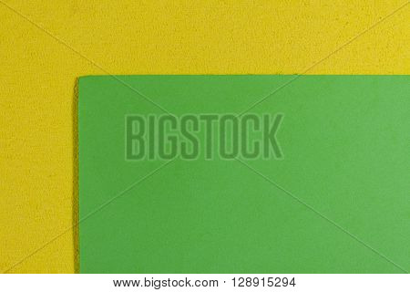 Eva foam ethylene vinyl acetate smooth apple green surface on lemon yellow sponge plush background