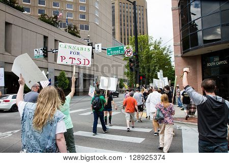 BOISE IDAHO/USA - MAY 7 2016: Group of people during their march to the capital in support for legal marijunana in Boise Idaho