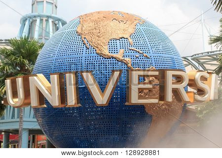 Singapore, Singapore - January 16, 2016: Universal globe at theme park Universal Studios Singapore on island resort Sentosa. The globe is the logo of the Universal Studios. The park opened in 2009.