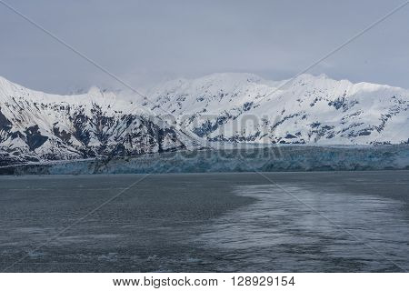 A Tidewater Glacier at Hubbard Bay with Snowy Mountains in the Background