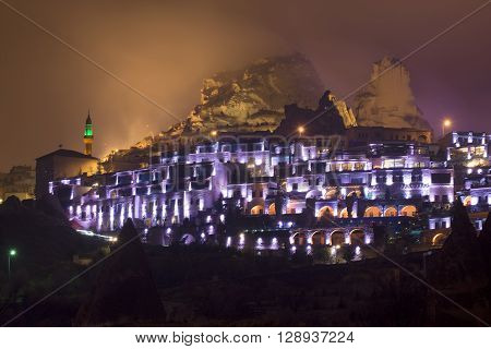 The fortress town of Uchisar, foggy night. Turkey