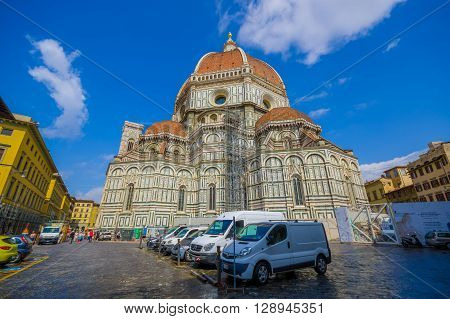 FLORENCE, ITALY - JUNE 12, 2015: Back view of Florence Cathedral, big and emblematic church of city. Cars behind in the street.