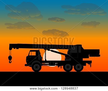 truck crane for lifting is worth of building materials in the evening at sundown
