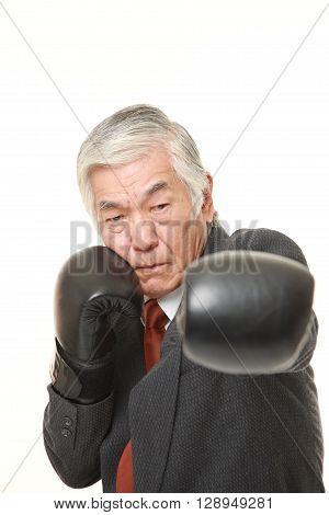 senior Japanese businessman throwing a left jab