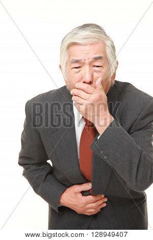 portrait of senior Japanese businessman feels like vomiting