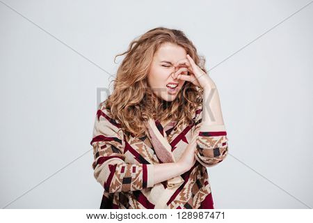 Woman with disgust emotion standing isolated on a white background