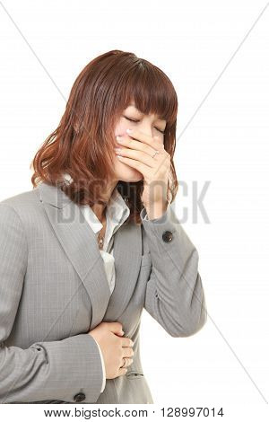 portrait of young Japanese businesswoman feels like vomiting