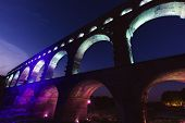 Pont du Gard at night. Vers-Pont-du-Gard Gard France. poster