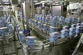 automated production line in modern dairy factory **Note, purposely blurry  poster