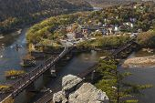 The historical town of Harpers Ferry, West Virginia, located at the confluence of the Potomac and Shenandoah Rivers,  as viewed from Maryland Heights. poster