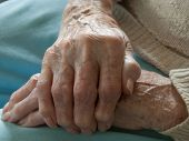 Close-up of woman gripping hand having arthritis poster