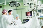 surgeons team hands during laparoscopic abdominal operation in child surgery  poster