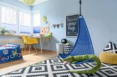 Fun child room arranged in scandinavian style with work space and fun accessories poster
