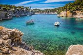 National park of Calanques in Provence. The picturesque gulf with turquoise water at coast of the Mediterranean Sea. Graceful sailing yachts in the sea fjord poster