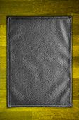 Black leather texture on the wood floor poster