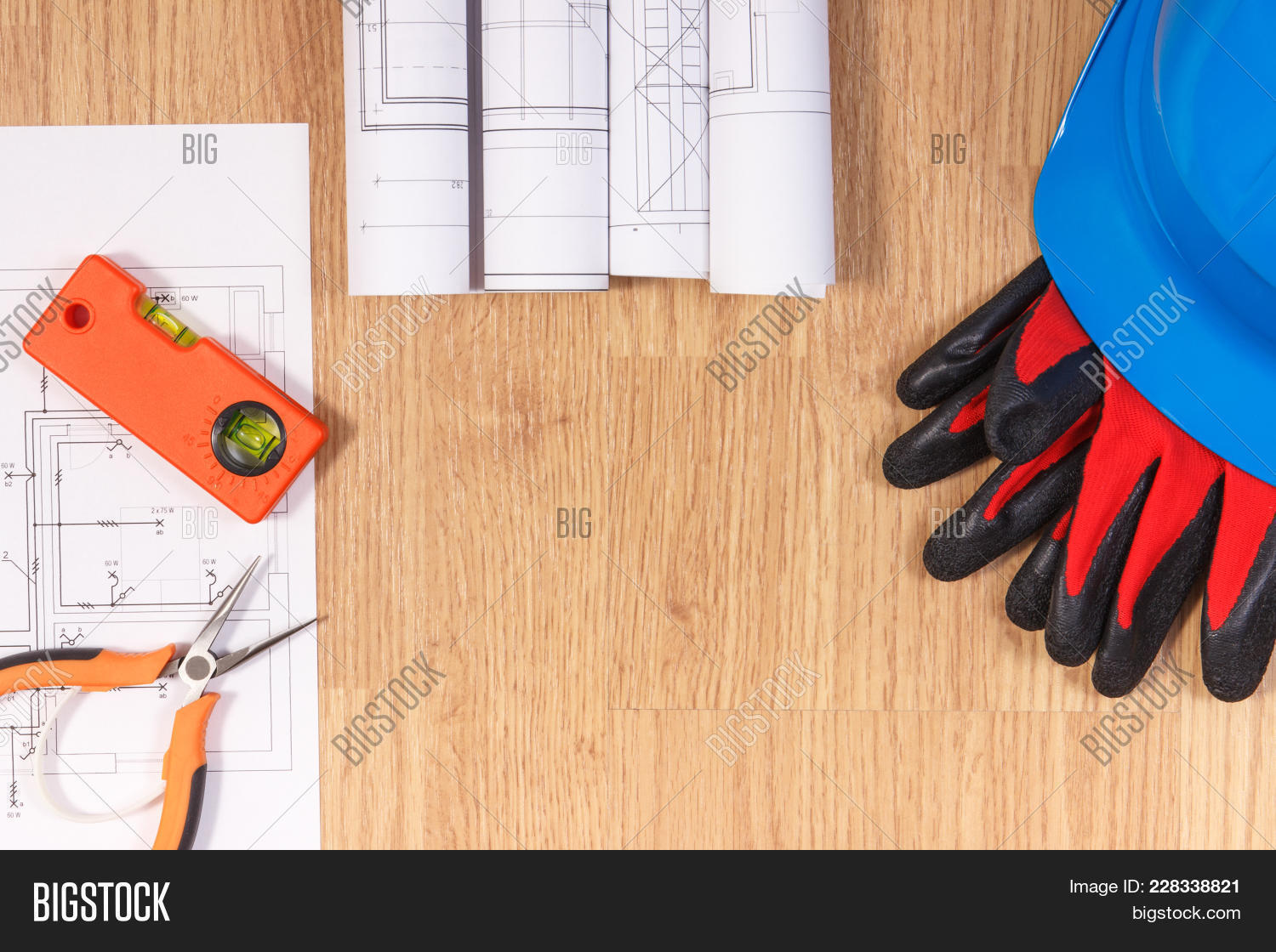 Diagrams electrical construction image photo bigstock diagrams or electrical construction drawings protective helmet with gloves and orange work tools a ccuart Image collections