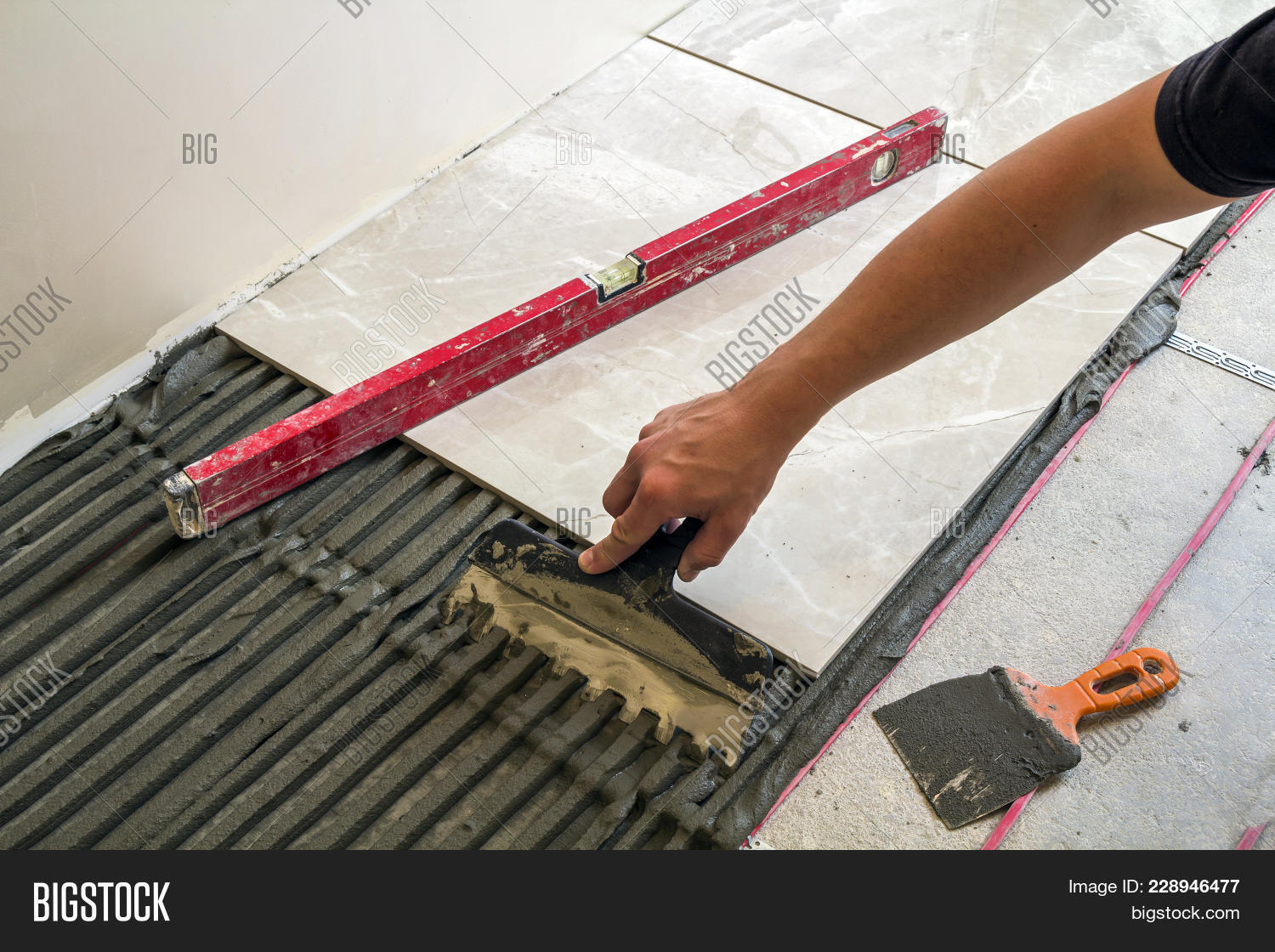 Ceramic tiles tools tiler worker image photo bigstock ceramic tiles and tools for tiler worker hand installing floor tiles home improvement dailygadgetfo Image collections
