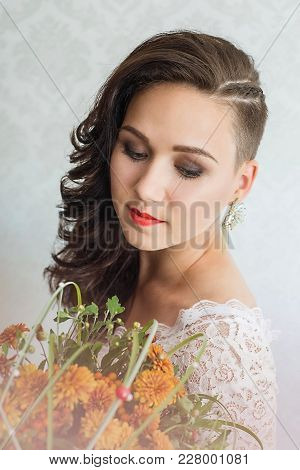 Close Up Portrait Of Young Beautiful Woman Bride In White Dress Looking Down, Holds A Wedding Bouque