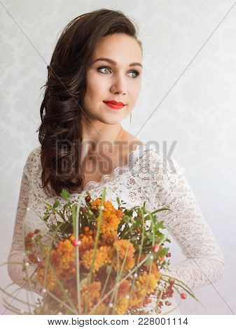 Close Up Portrait Of Young Beautiful Woman Bride In White Dress, Holds A Wedding Bouquet In His Hand