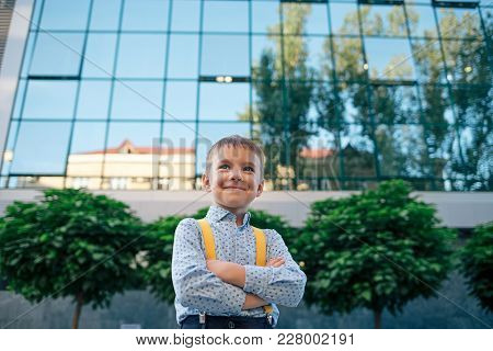Boy Portrait, Down Angle, Future Businessman, Wearing Yellow Suspenders, Blue Shirt Against Office B