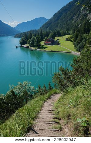 Popular Adventure Trail Along The Lakeside Of Achensee, With View To Gaisalm Hut, Austrian Spring La