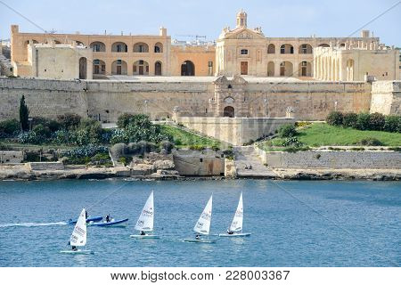 Regatta Of Sailboats In Front Of Fort Manoel On Malta