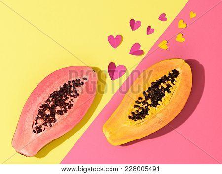 Papaya Tropical Fruit. Vanilla Pastel. Bright Sweet Color. Flat Lay. Trendy Fashion Style. Minimal.