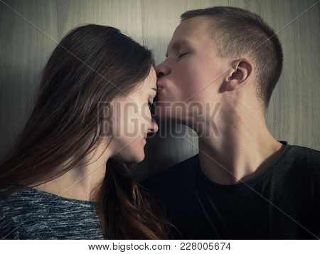 The Young Man Gently And Gently Kisses The Girl. Emotional Portrait