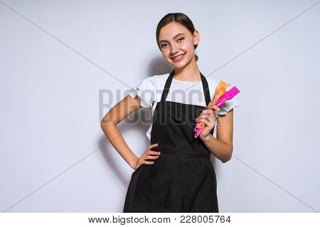 Happy Smiling Girl Cook In Black Apron Holds In Hands Cooking Tools