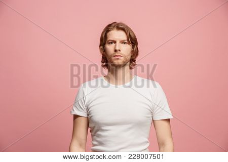 Serious Business Man Standing, Looking At Camera Isolated On Trendy Pink Studio Background. Beautifu