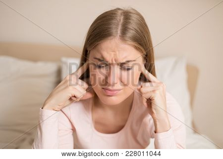 Angry Woman Disturbed With A Noise Having Problems With Sleeping.