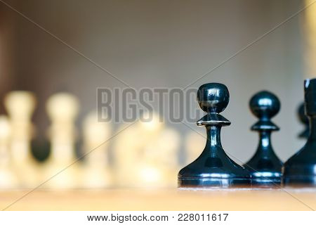 Close Up View Of Chess Pieces Lined Up On A Chess Board Ready For A Game With Selective Focus To A B