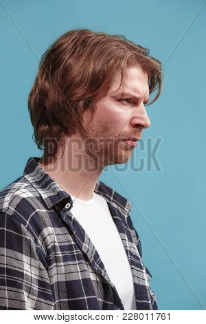 Serious Business Man Standing, Looking At Camera Isolated On Trendy Blue Studio Background. Beautifu