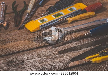 Construction Tools On A Wooden Surface. Tools Background With Copy Space.