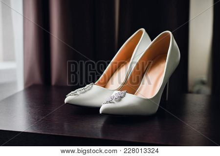 Wedding White Bride Shoes With Silver Earrings With Diamonds At Morning Gatherings
