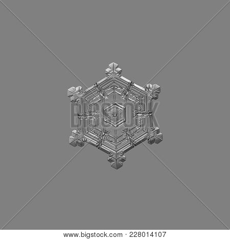 Snowflake Isolated On Uniform Gray Background. Macro Photo Of Real Snow Crystal: Sectored Plate With