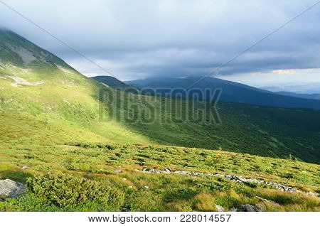 Mountain Green Valley In The Carpathian Mountains. The Picture Is Taken On A Summer Evening.