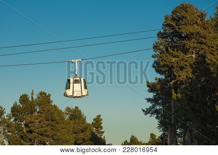 Cable Cabin In French Pyrenees On A Late Afternoon With Blue Skys And Forest